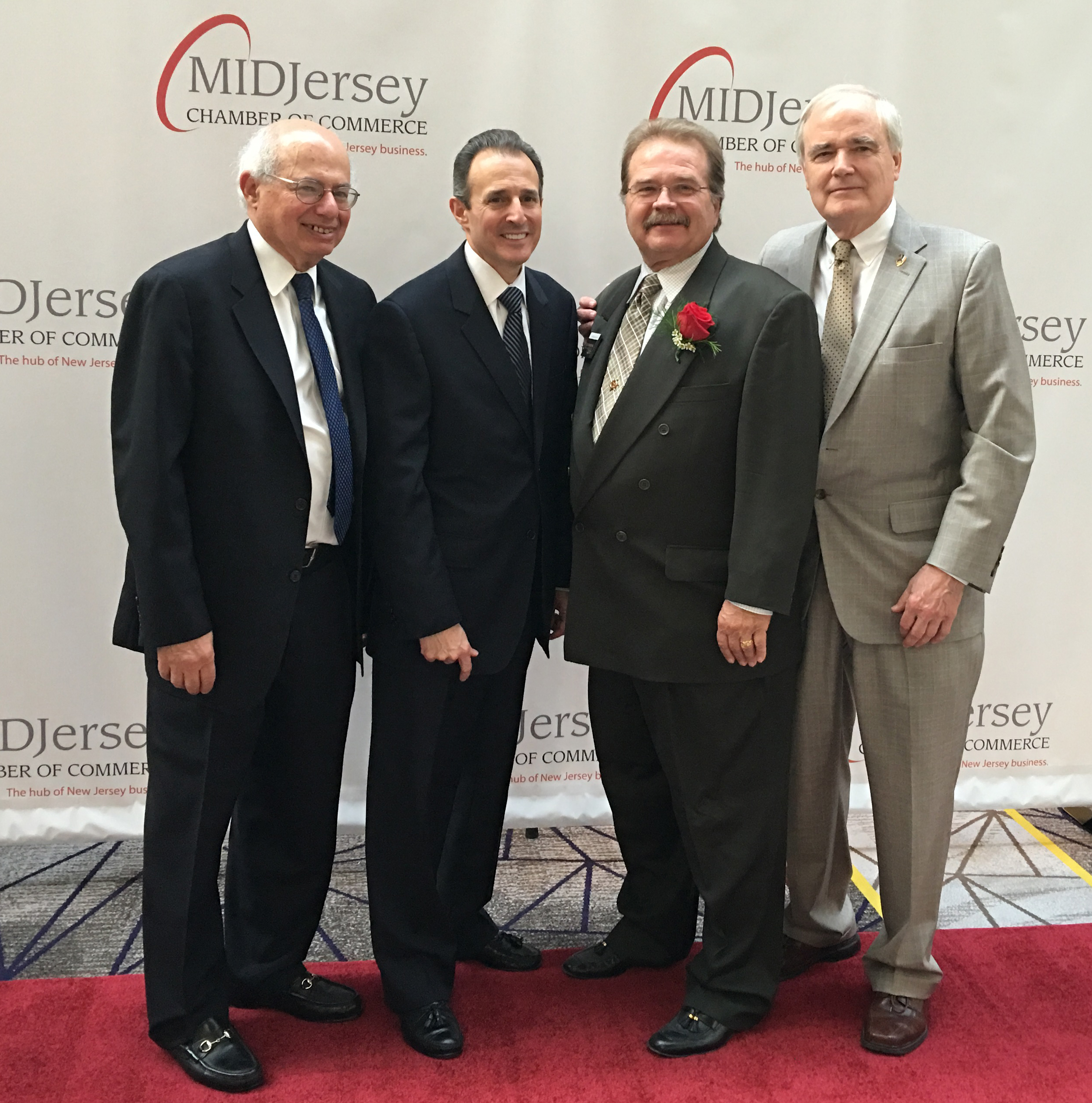 (L-R) Barry Szaferman, founding partner, Szaferman, Lakind, Blumstein & Blader, P.C.; Jim Bartolomei, principal-in-charge, HBK CPAs & Consultants, Jeffrey Barnhart, Creative Marketing Alliance (CMA) founder, CEO and Outstanding Small Business of the Year honoree; and Patrick M. Ryan, chairman of the board, First Bank, celebrate CMA's more than 29 years of business success at the MIDJersey Chamber of Commerce Annual Awards Gala on April 21 at the Hyatt Regency in Princeton.