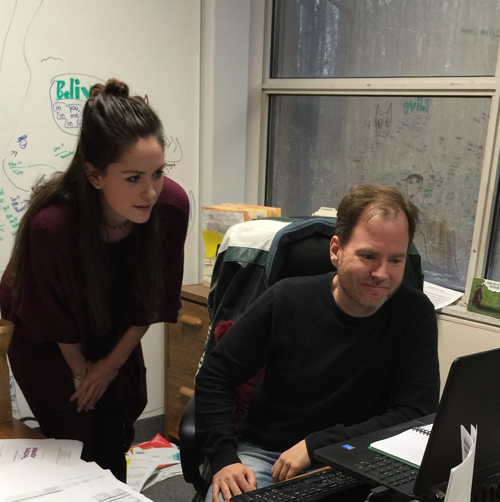 College of New Jersey marketing major Carly Choffo, who lives in Old Bridge, works with Rick Verbanas, marketing and business development director, to further her understanding of marketing as part of her internship at Creative Marketing Alliance.