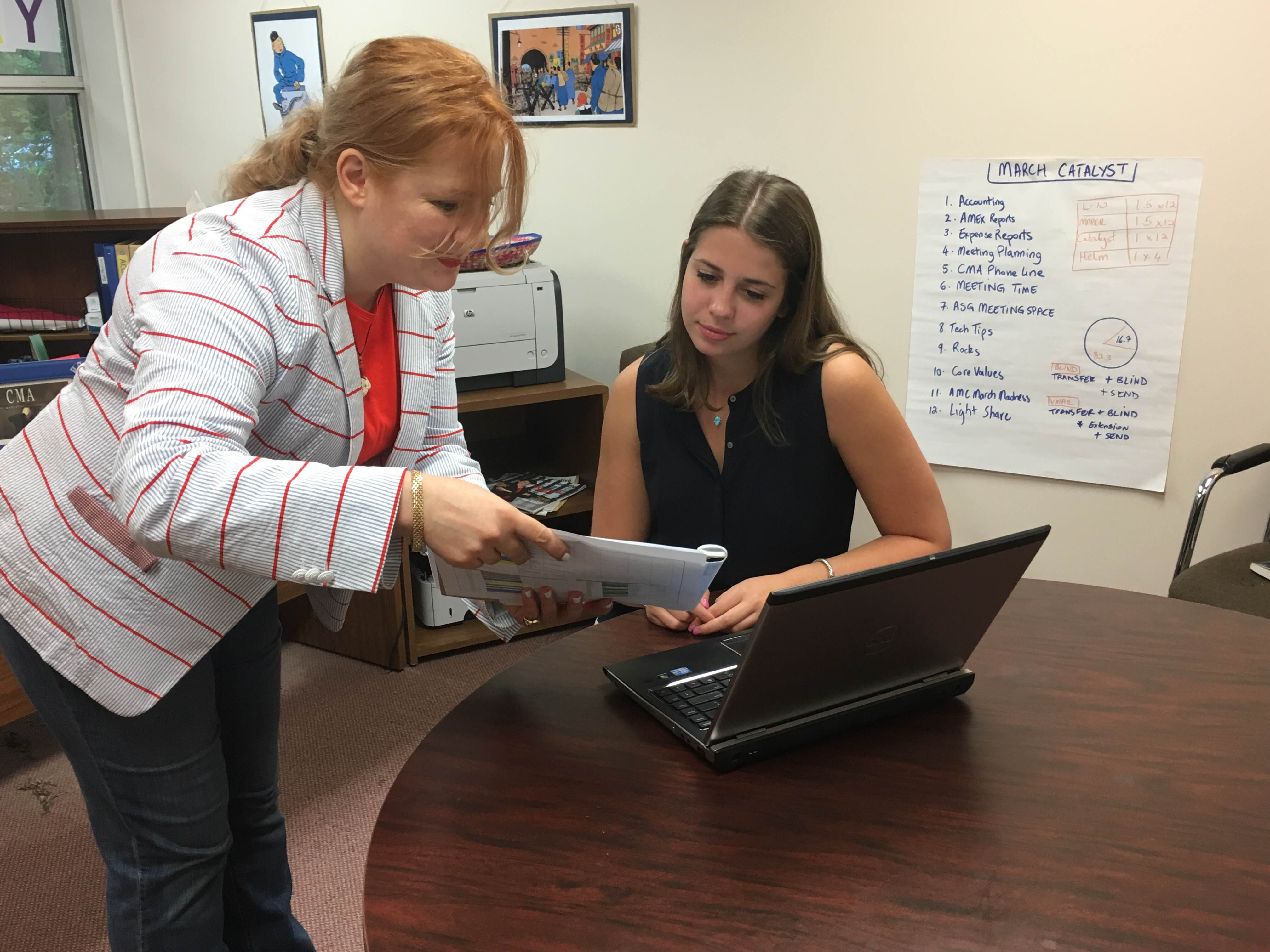 CMA Intern Jordannah Schreiber works with Gabrielle Copperwheat, director of operations on a marketing project.